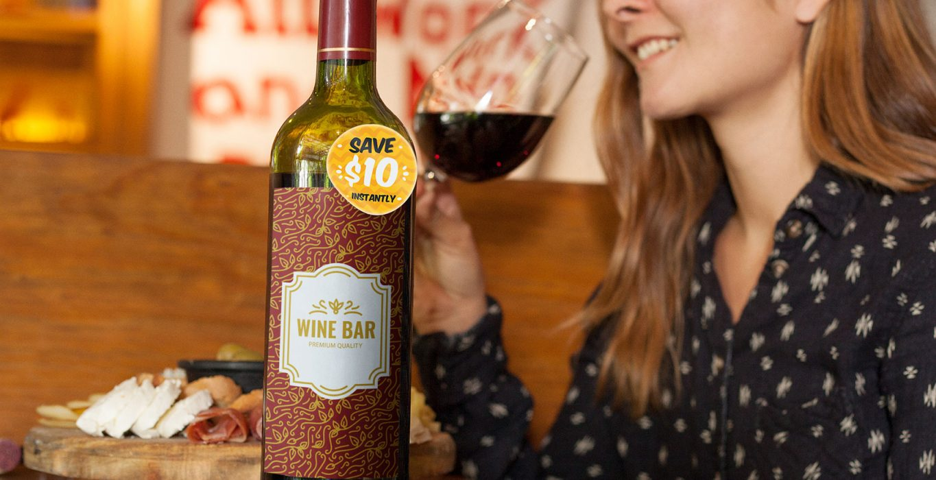 label-mockup-of-a-wine-bottle-sitting-on-top-of-a-restaurant-table-a6989.jpg